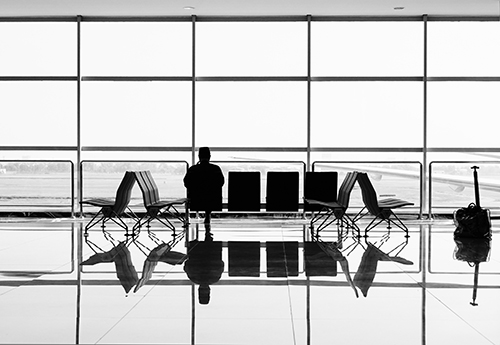 Photo of a man sitting at the airport